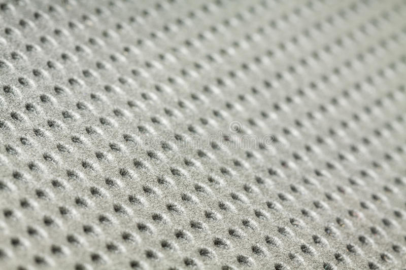 Holes in grey foam texture (for background)