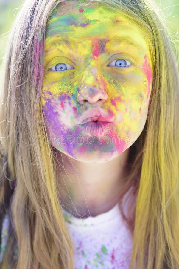 Holi. colorful neon paint makeup. Happy youth party. Optimist. Spring vibes. Crazy hipster girl. Summer weather. Positive and cheerful. child with creative stock images
