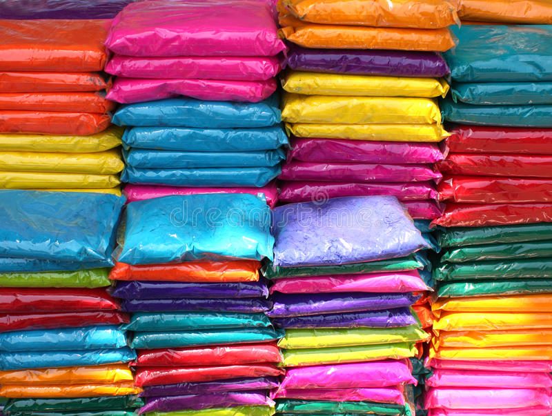 Holi Colors Background. A background of plastic packets containing colorful powder for the traditional celebration of holi festival in India stock photography