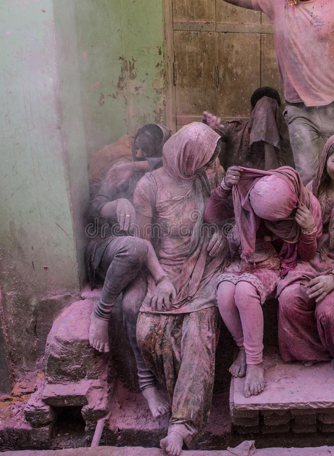 Holi festival in Barsa and Mathura India is an adventure when people throw on each other colored powder. People sitting on the street in the villages of Barsa royalty free stock photos