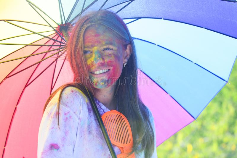 Holi girl with umbrella. children with creative body art. Happy youth party. Optimist. Spring vibes. positive and. Cheerful. colorful paint makeup. Crazy stock images