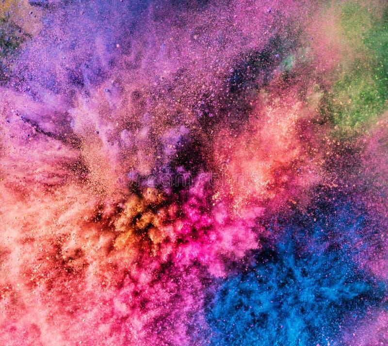 Holi powder bursting up, creating exploding texture. Festival of colors. Vivid background royalty free stock photo