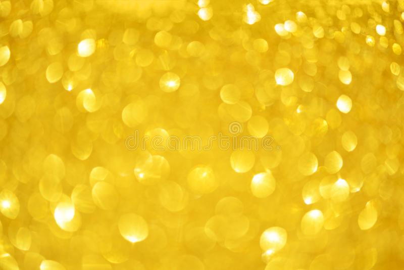Holiday abstract texture. Christmas card with copy space. Gold bokeh background, defocused lights royalty free stock photography
