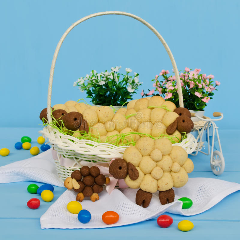 Holiday almond biscuits lamb in a basket. Square. Holiday almond biscuits lamb in a basket on the Easter table. Square stock images
