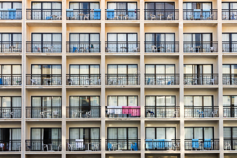 Holiday apartment block. Modern hotel building exterior with towels hunging onbalconies