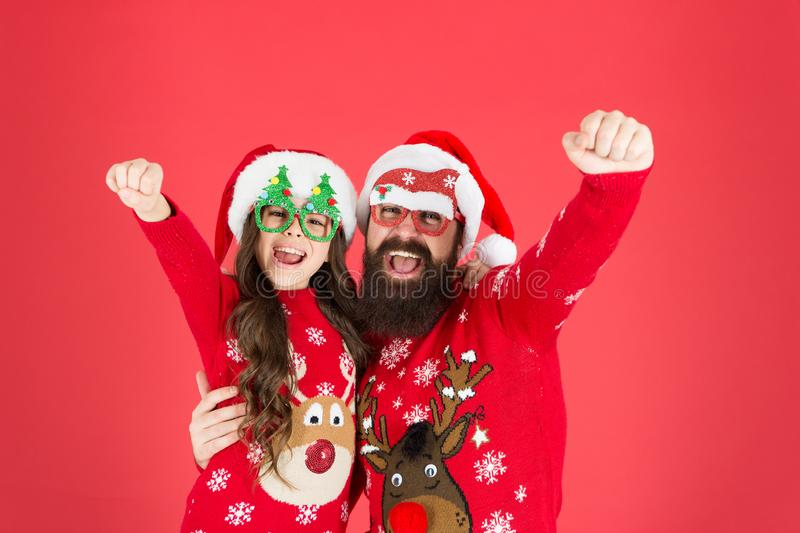Holiday atmosphere. winter holiday with family. happy father and daughter love xmas. small girl and dad santa hat. daddy stock photos