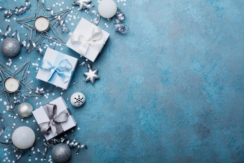 Holiday background with christmas decoration and gift boxes top view. Festive greeting card. Flat lay style. stock photos