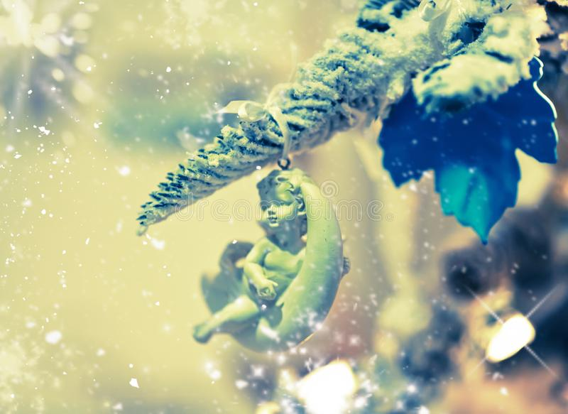 Holiday background.Christmas tree with angel toy stock image