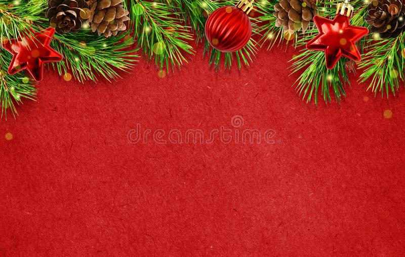 Holiday background with Christmas tree twigs, cones, balls abd l stock images