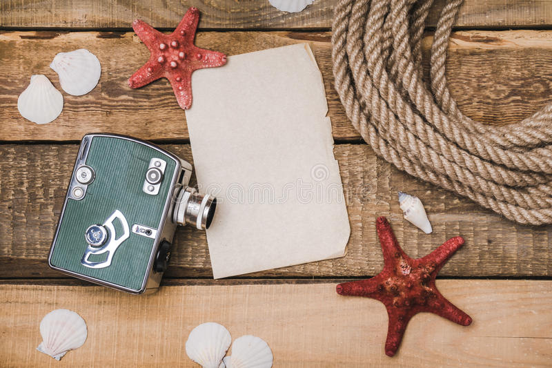 Holiday background with paper, rope and a camera royalty free stock photo