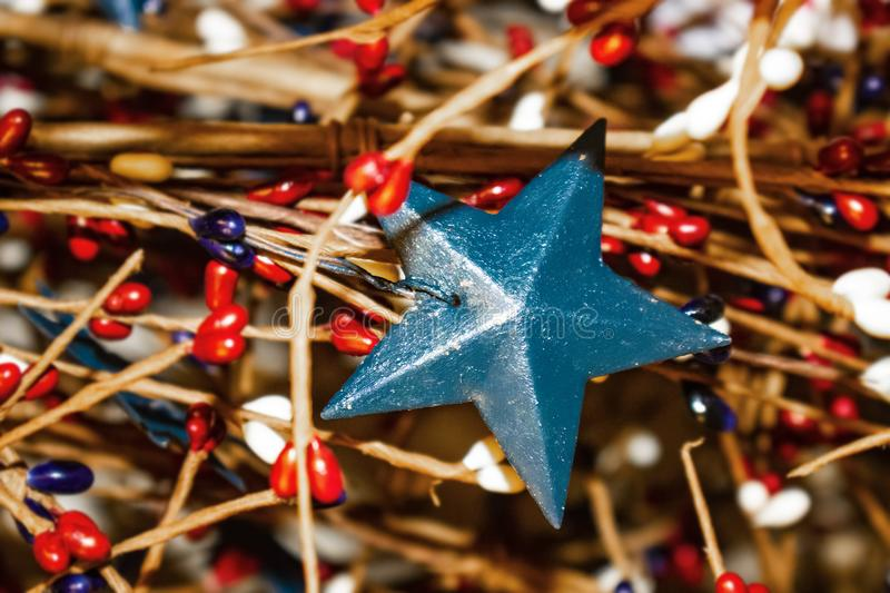 Holiday background with red white and blue blurred elements - focus on rustic blue metal star stock image