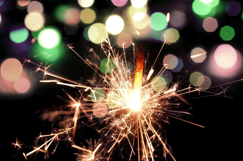 Holiday background with a sparkler. stock image