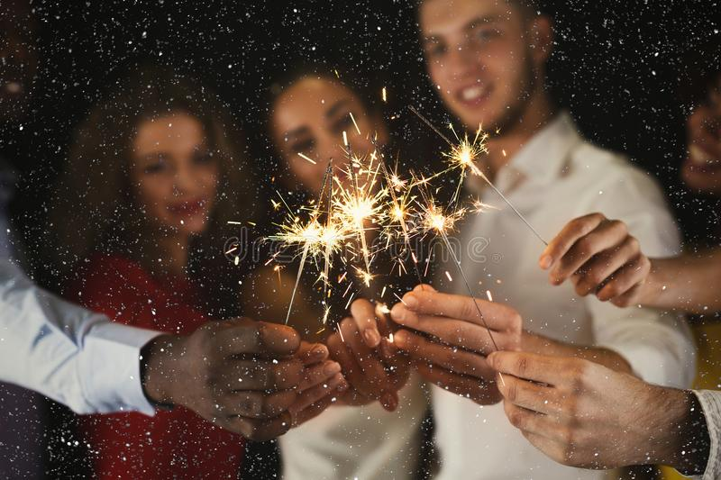 Sparklers background. Young people at celebration party stock images