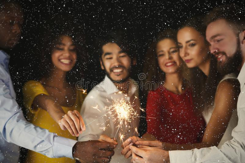 Sparklers background. Young people at celebration party stock photo
