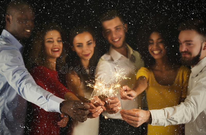 Sparklers background. Young people at celebration party royalty free stock images