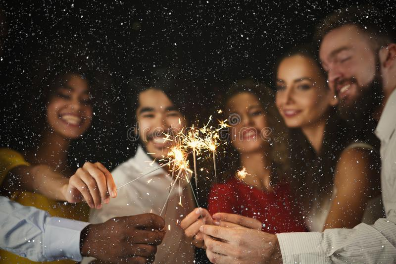 Sparklers background. Young people at celebration party royalty free stock image