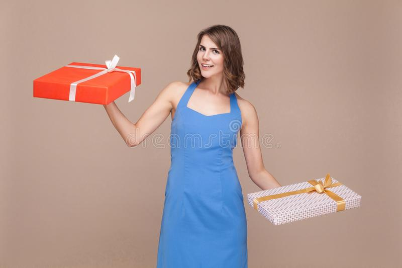 Holiday or birthday concept. Happiness woman holding two gifts b royalty free stock photos