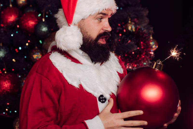Holiday bomb. Shocked Santa. Surprise for the party. Christmas ball shaped explosives. Funny idea for holidays. stock images