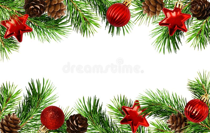 Holiday borders with Christmas tree twigs, cones, and balls royalty free stock photo