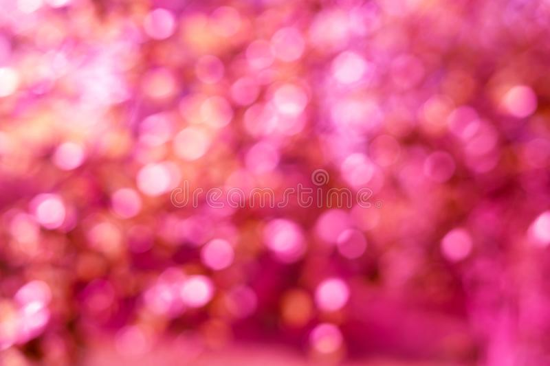 Holiday bright pink lights bokeh background stock image