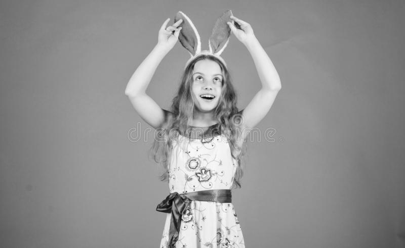 Holiday bunny girl with long bunny ears. Child cute bunny costume. Playful baby celebrate easter. Spring holiday. Happy royalty free stock images
