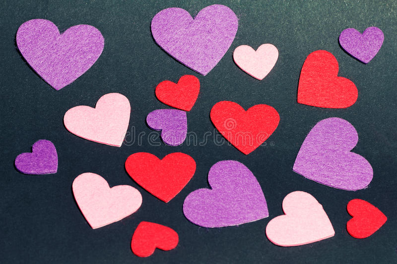 Holiday card with hearts on black royalty free stock photo