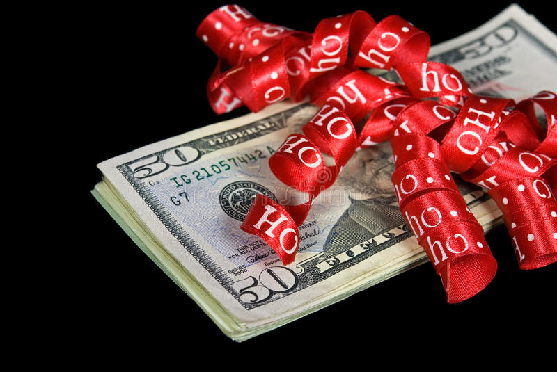 red Christmas ribbon on cash royalty free stock image