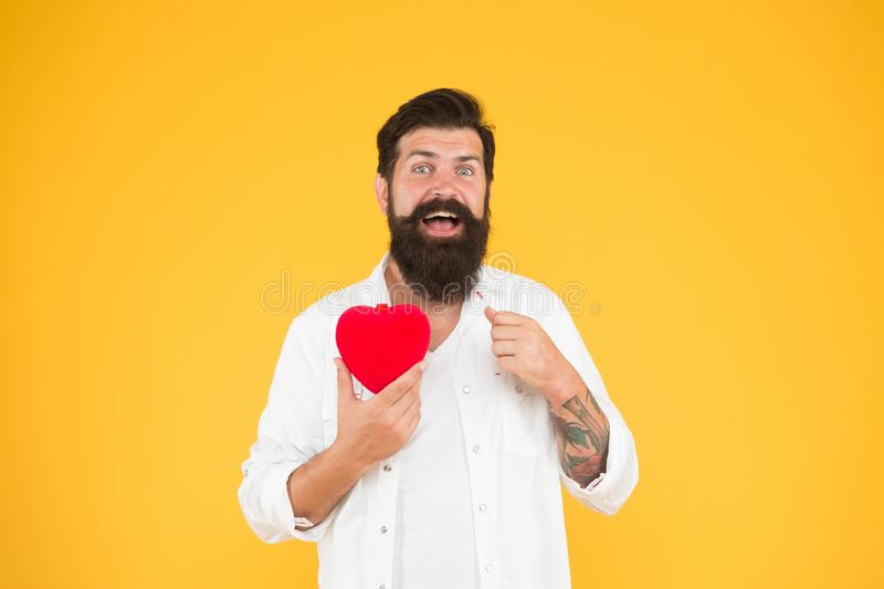 Holiday celebration. love and romance. being human organ donor. bearded man red heart. brutal hipster care of his heart. Let me be your valentine. Health care royalty free stock images