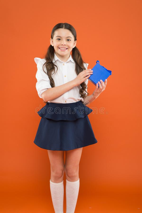 Holiday celebration. Rewarding for efforts. Girl opening gift. Tidy adorable pupil open gift box. Educational program stock photos