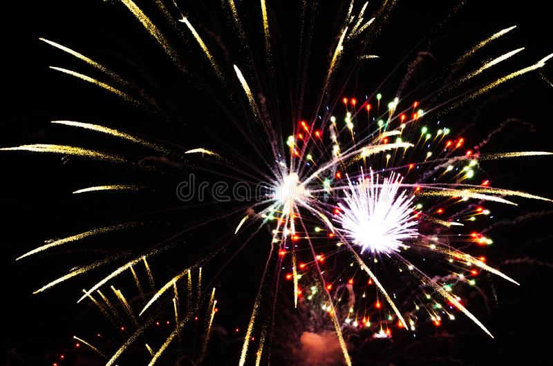 Holiday, celebration - two flashes of colorful fireworks in the royalty free stock images