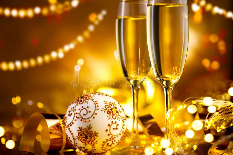 Holiday Champagne Flute over Golden glow background. Christmas and New Year celebration. Two Flutes with Sparkling Wine stock photo