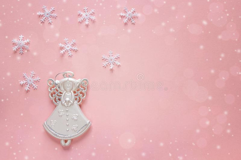 Holiday christmas background with angel on pink. Copy space. Greeting card stock photos