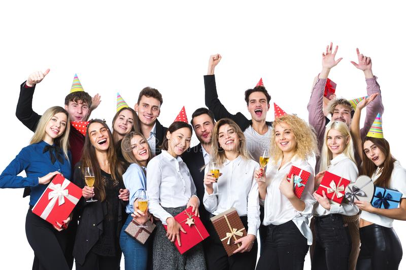 Happy people celebrating holiday with champagne. royalty free stock image
