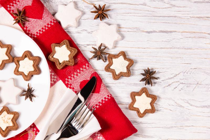 Holiday concept with napkin, cutlery, cookies and spices royalty free stock images
