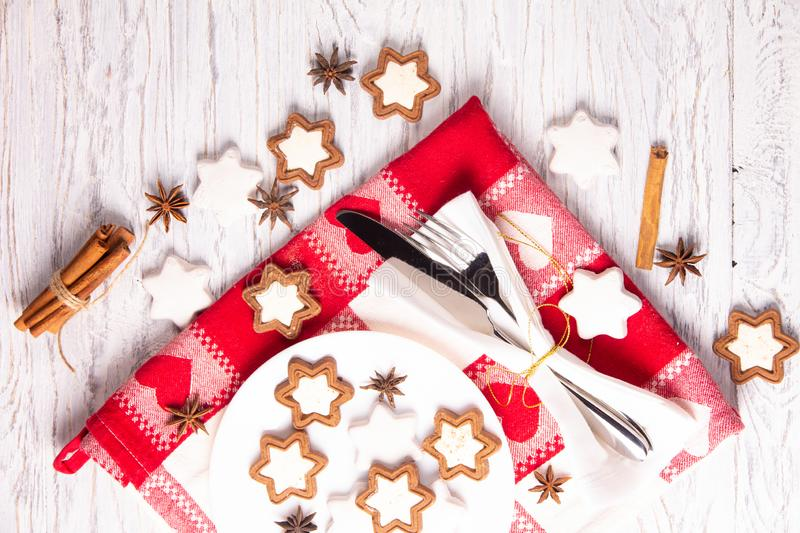 Holiday concept with napkin, cutlery, cookies and spices royalty free stock image