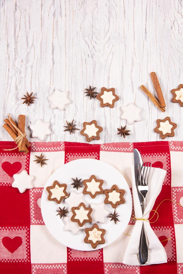 Holiday concept with napkin, cutlery, cookies and spices royalty free stock photography