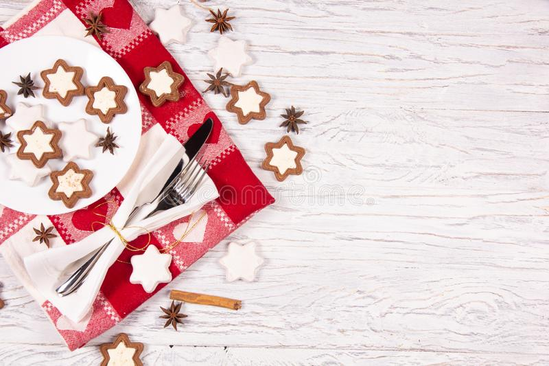 Holiday concept with napkin, cutlery, cookies and spices stock photography