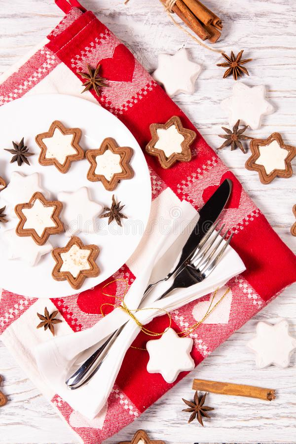 Holiday concept with napkin, cutlery, cookies and spices stock image