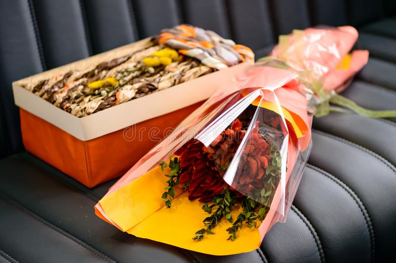Holiday decor concept. Handmade gift box and creative bouquet of royalty free stock image