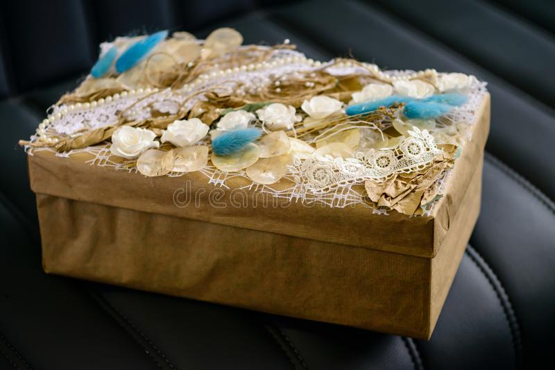 Holiday decor concept. Handmade gift box wrapped with craft pap royalty free stock photo