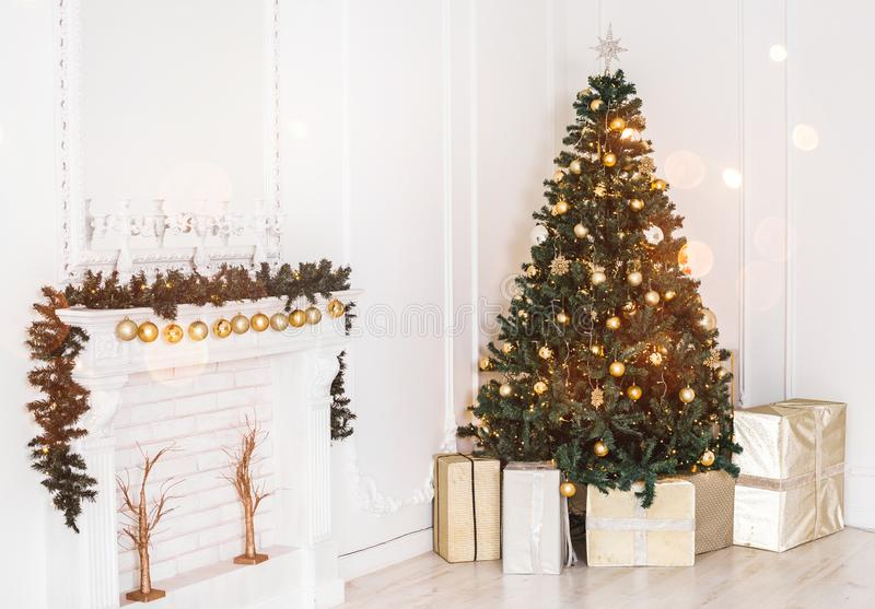 Holiday decorated room with Christmas tree and decoration, background with blurred, sparking, glowing light. royalty free stock photography