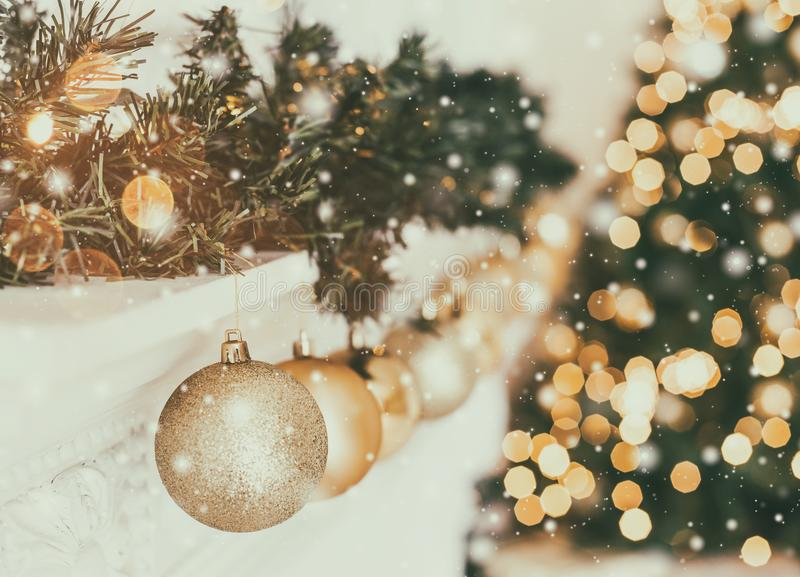 Holiday decorated room with Christmas tree and decoration, background with blurred, sparking, glowing light. Happy New Year and Xmas theme, toning stock photography