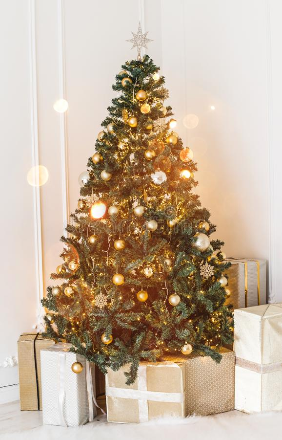 Holiday decorated room with Christmas tree and decoration, background with blurred, sparking, glowing light. Happy New Year and Xmas theme, toning royalty free stock photos