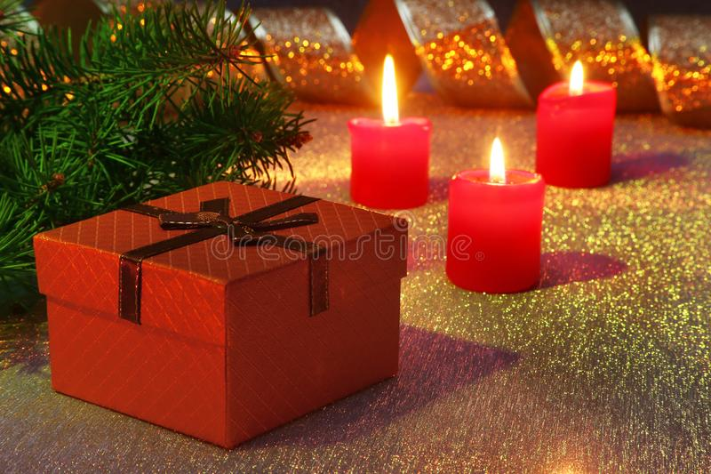 Holiday decoration with gift boxes, christmas candles, tree and colorful christmas balls. Selective focus. stock photos