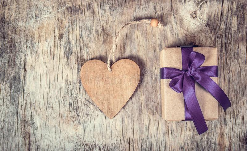 Holiday decorations with gift box and wooden valentine. Wooden heart. royalty free stock photo