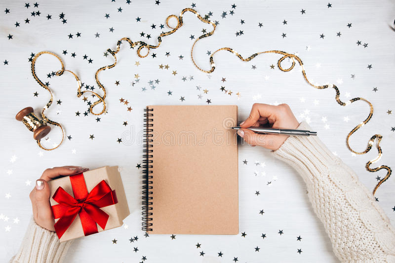 Holiday decorations and notebook. With on white rustic table, flat lay style. Planning concept royalty free stock photos