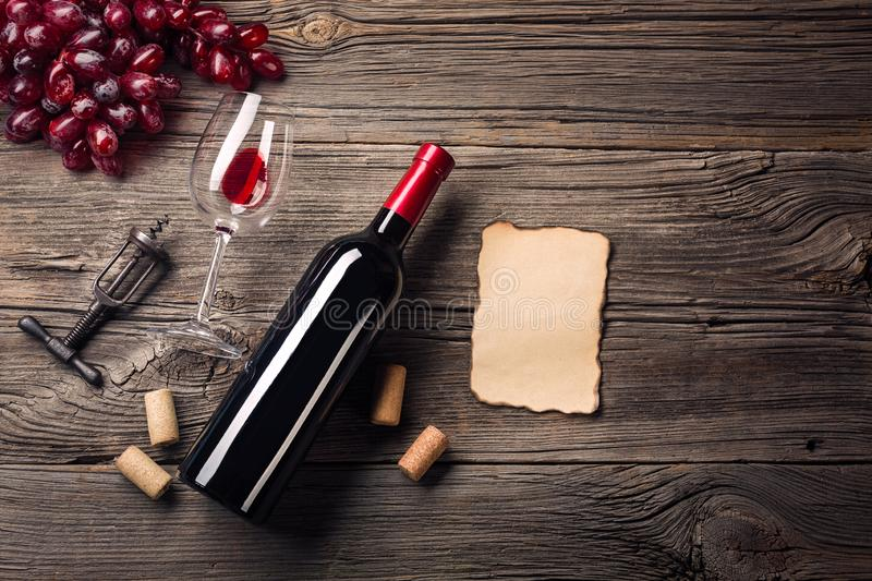 Holiday Dinner setting with red wine and gift on rustic wood. Top view with space for your greetings stock photos