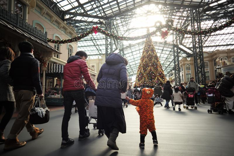 Holiday family At the theme park with Christmas trees in winter. December 2017. Holiday family At the theme park with Christmas trees in winter stock photos
