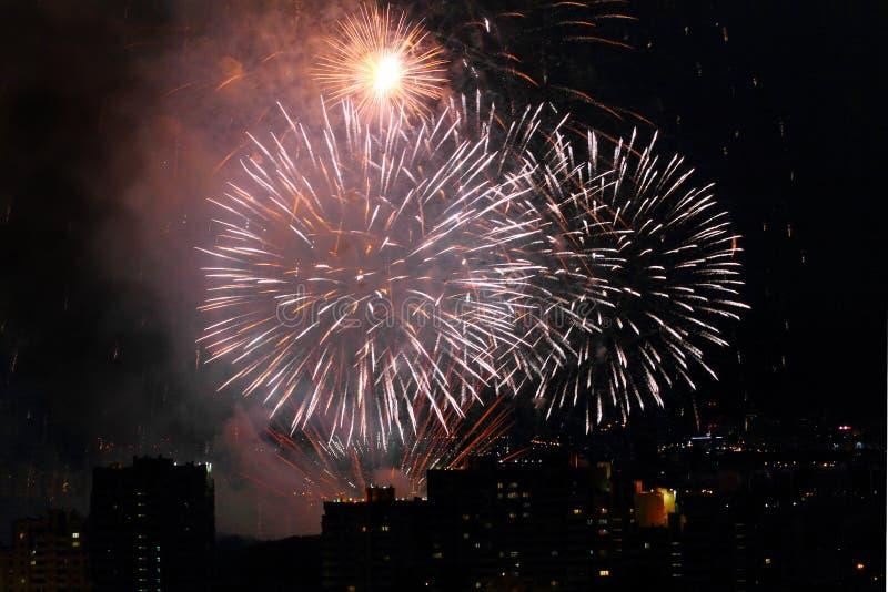 Holiday firework at night sky over city royalty free stock photos