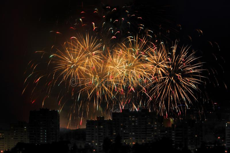 Holiday firework at night sky over city. Multicolored holiday firework at night sky over city stock photo